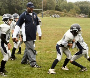 Members of the Pottstown Police Athletic League's Patriots football team practiced yesterday morning (Sept. 27, 2008) before their game at the fields behind Lower Pottsgrove Elementary School.