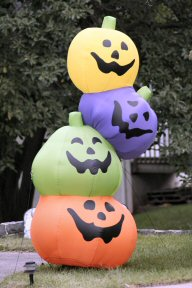 An inflatable tower of multi-colored jack-o-lanterns decorates the lawn of a home on East High Street in Sanatoga's business district.