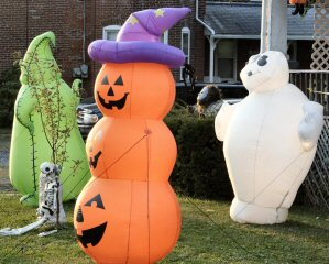 White ghosts, green goblins, and stacked jack-o-lanterns decorate an East High Street, Sanatoga, lawn east of North Pleasantview Road.