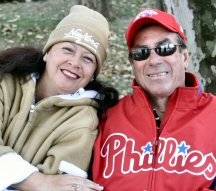 "Newlyweds Corine and ""Kona"" Bill Lapish of Hawaii, who traveled Saturday through greater Pottstown while on their honeymoon, show their Phillies' pride."