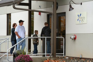 Visitors arrive at Saturday's open house at the new health care clinic.
