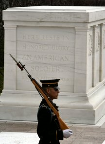A guard parades in front of the Tomb Of The Unknowns at Arlington National Cemetery, Arlington VA.