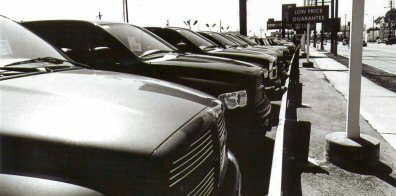 Dodge trucks sit on a dealer's lot.
