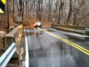 A car travels across the Sunnybrook Road bridge over Sprogels Run, north of East High Street in Sanatoga.