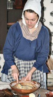 Wentz Farmstead educator Kim Boice mixes batter for griddlecakes.