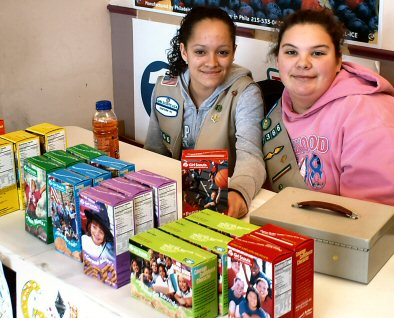 Desiree Colon, left, and Mary Jo Brurner sell Girl Scout cookies Sunday (Jan. 25, 2009) at Thriftway in Sanatoga PA.
