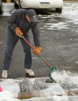 Pete Kunrath attacks his Bradley Way driveway with a shovel.
