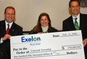 State Rep. Tom Quigley, left, joins Renee Chesler, vice chairman of the Limerick Township Board of Supervisors, and Limerick Generating Station Plant Manager Ed Callan, with a mock check representing Exelon Corp.'s $150,000 donation.