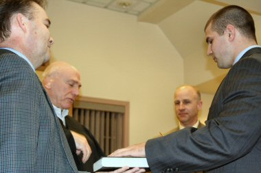 Officer Richard Smith, right, is sworn in as a member of the Lower Pottsgrove Police Department.