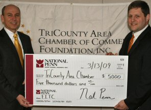 National Penn Bank's Scott Gruber, left, presents chamber President Timothy Phelps with a $5,000 check.