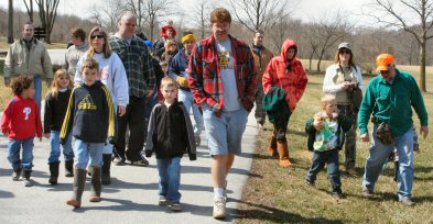 Rubber-booted Cub Scouts and their accompanying adults head toward French Creek to help with its trout-stocking Saturday.