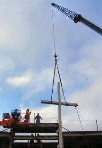 The cross is raised into place.