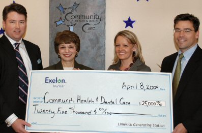 Displaying their check, from left: CHDC's Stephen Ross and Mary Ann Dailey, and Exelon's Government Affairs Manager Jeannie Liggett and Limerick Site Vice President Chris Mudrick.