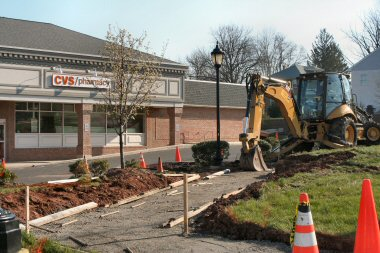 Among the changes outside CVS in Sanatoga, a ramp from the East High Street sidewalk to its parking lot.