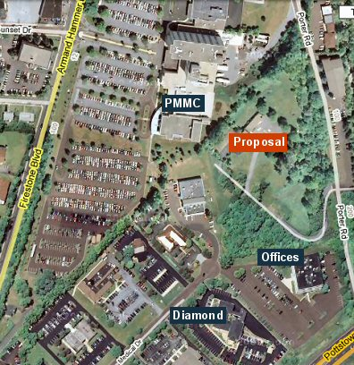 A satellite view of the area shows where the proposed facility would be located relative to the hospital, Diamond Credit Union, and the office building, all on Medical Drive.