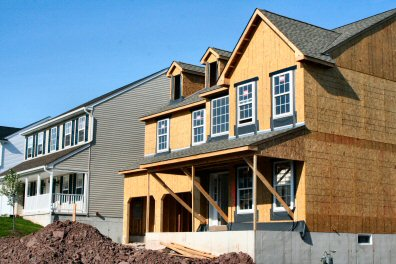 A home under construction at 32 Canyon Creek Dr., Gilbertsville PA, sits unfinished between already completed properties.