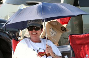 For this flea market vendor Sunday in Barto, an umbrella was the only way to cope with the sun.