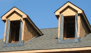 Unsecured, unfinished dormers atop a roof at THP's Kingston Hill development.