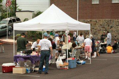 Flea market customes swarmed across the Sanatoga Fire Co. parking lot.