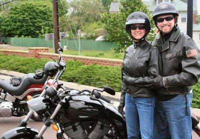 Dianne Strunk, left, and John Williamson arrive in Sanatoga during Sunday's Poker Run ride.