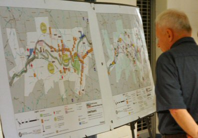 A visitor to Tuesday's meeting on Route 422 inspects regional maps.