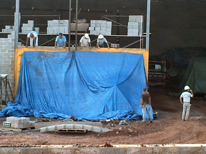 A crew labors on a wall at the expanded Center's west side.