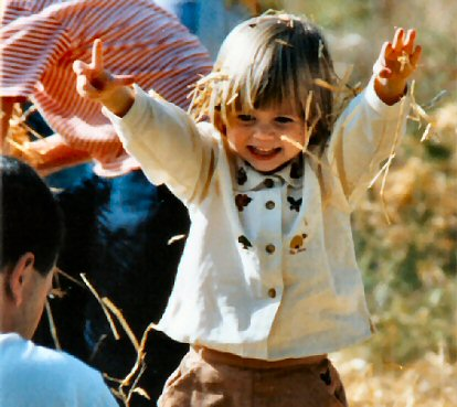 A young girl plays among hay bales during the All Hallow's Festival at Pennypacker Mills ... on Oct. 19, 1997.